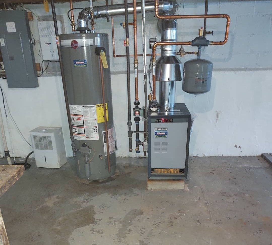 BOILER AND WATER HEATER REPLACEMENT