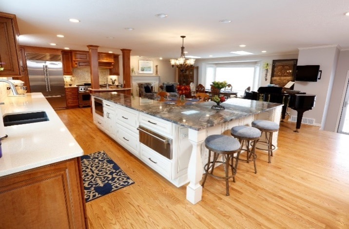 Open-Concept Chef's Kitchen & Living Space With Tuscan Flair