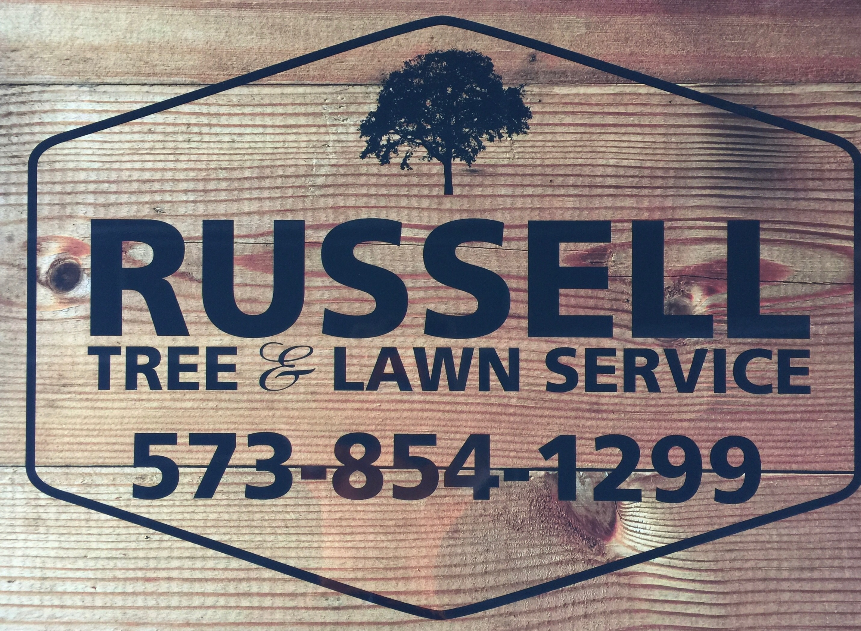 Russell Tree & Lawn Service logo