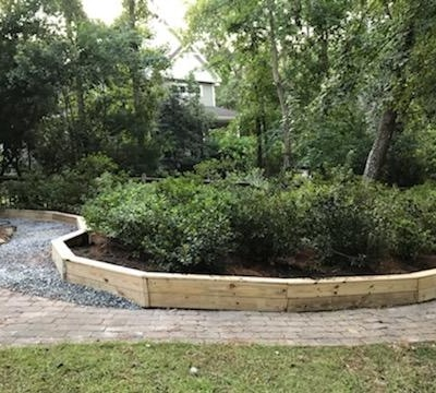 Raised garden bed Azalea transplant and gravel walkway