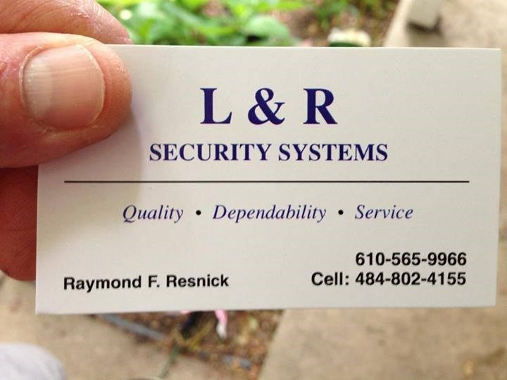 L & R SECURITY SYSTEMS logo
